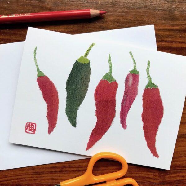 Chigiri-e Chillies created by Japanese artist Noriko Matsubara