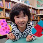 At Noriko Matsubara's author visit, children make their own Bocchi and Pocchi sock puppets.